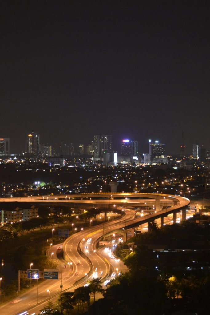 117604001 - beautiful aerial view of johor bahru's cityscape with highways and vehicles at night
